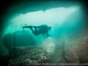 Diving through cave