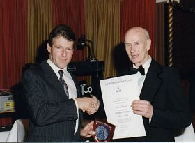 Martin Cox (left) on behalf of the club, receiving the Heinke award from George Brookes in 1993.